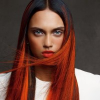 Long, straight, red hair with dark highlights