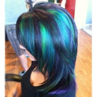 Long, colourful hairstylr with green highlights