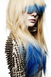 Long, messy looking hairstyle with blue endings and blunt fringe