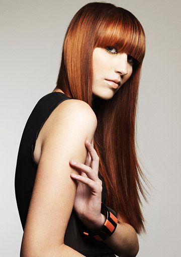 Long, red hairstyle with straight hair and blunt bangs