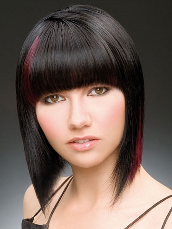 Short, straight haristyle with red highlights and blunt bangs