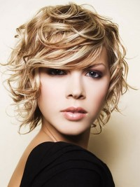 Short, curly, messy looking hairstyle