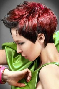 Short, red hairstyle with regular cut and dark sides