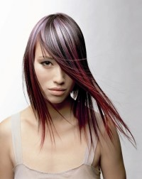 Long, colourful hairstyle with violet and red highlights