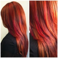 Long, red hairstyle with darker highlights