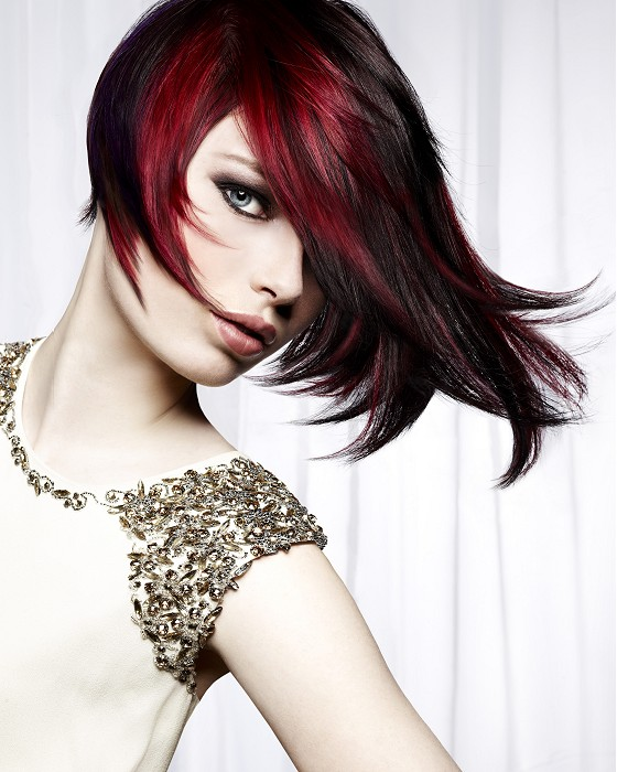 Medium-length, red hairstyle with black highlights