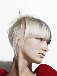 Short, pixie haircut with blunt bangs and single loose streaks