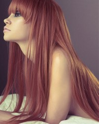 Long, red hairstyle with blunt bangs