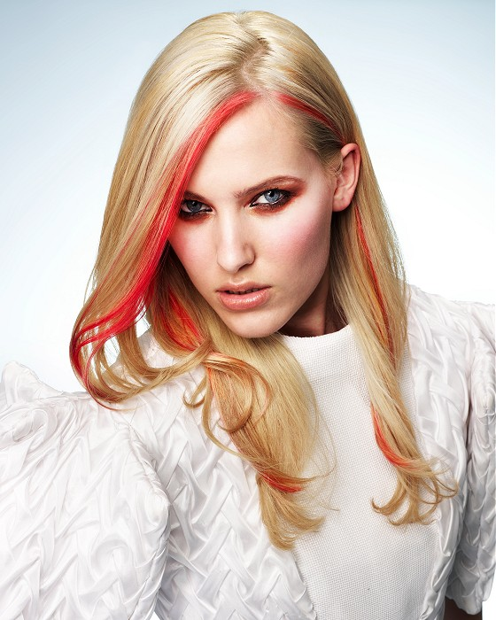Long Blond Hairstyle With Single Red Coloured Streaks Of