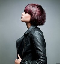 Short, bob style haircut with red highlights and blunt bangs