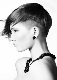 Short, pixie haircut with long fringe and shaved sides
