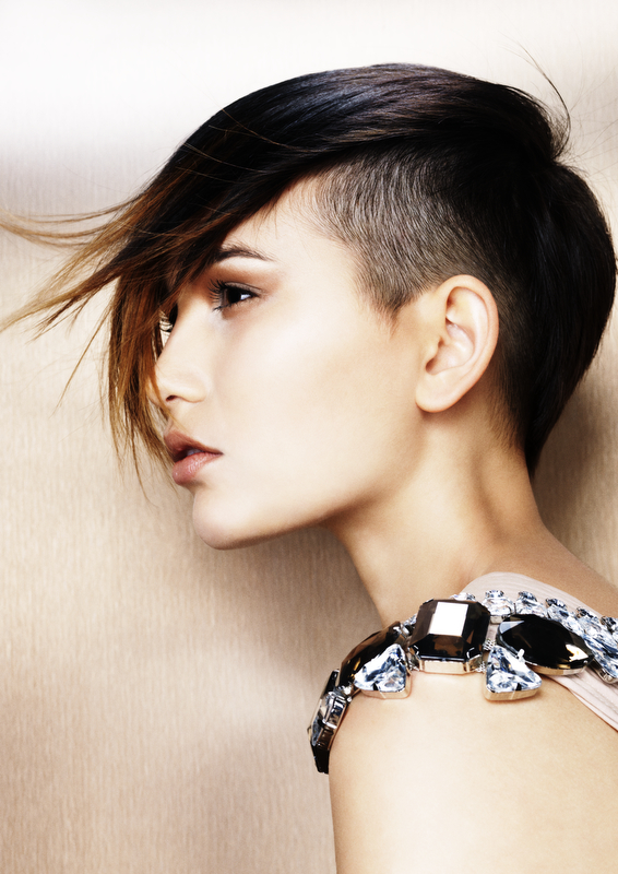 Short, brown hairstyle with long bangs and shaved side