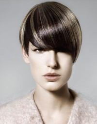 Short, brown hairstyle with blond highlights