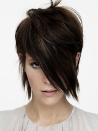 Short, choppy, brown hairstyle with long fringe