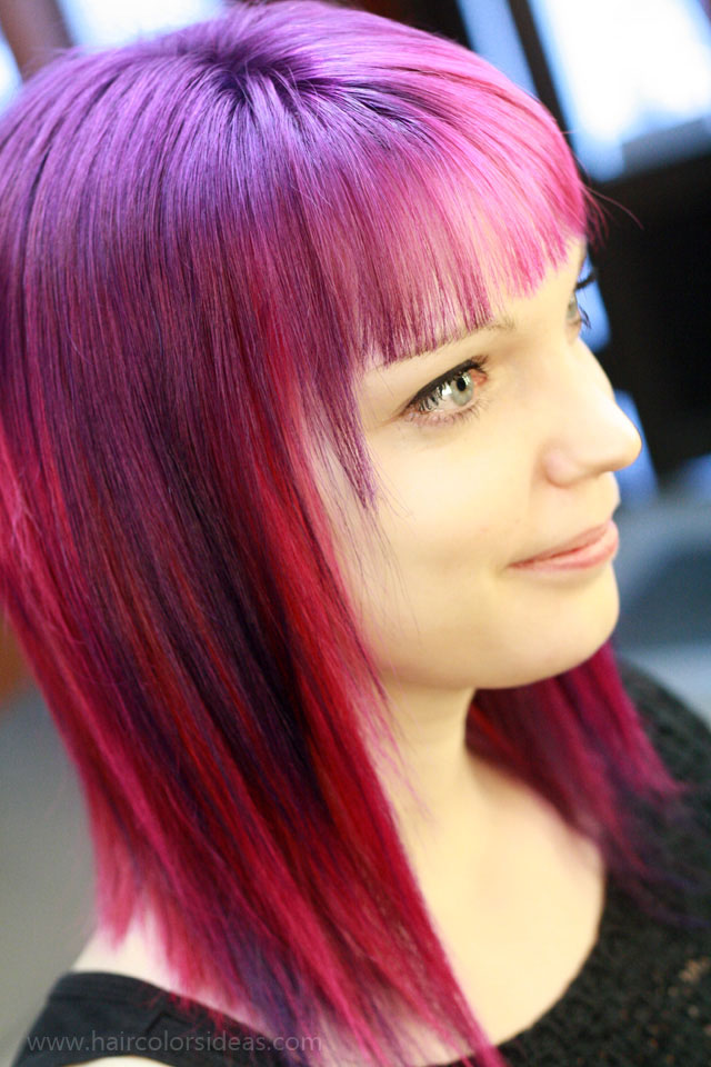 Medium-length, violet hairstyle with wispy bangs