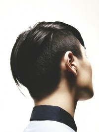 Short, pixie hairstyle with high fade and shaved sides