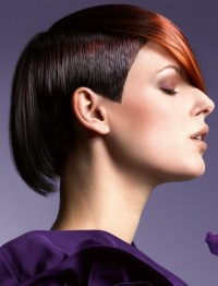 Short, pixie hairstyle with regular cut and brown fringe