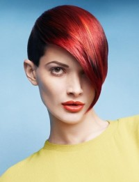 Short, red hair with long bangs and shaved sides