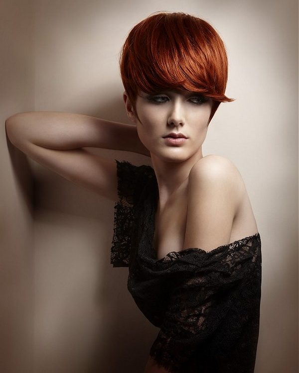 Short, red haicut with blunt bangs