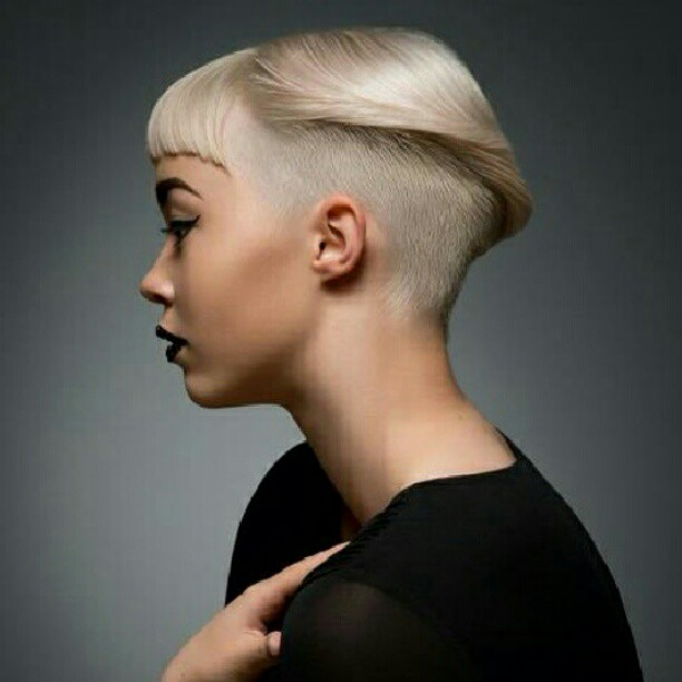 Short, pixie haircut with shaved sides and baby fringe
