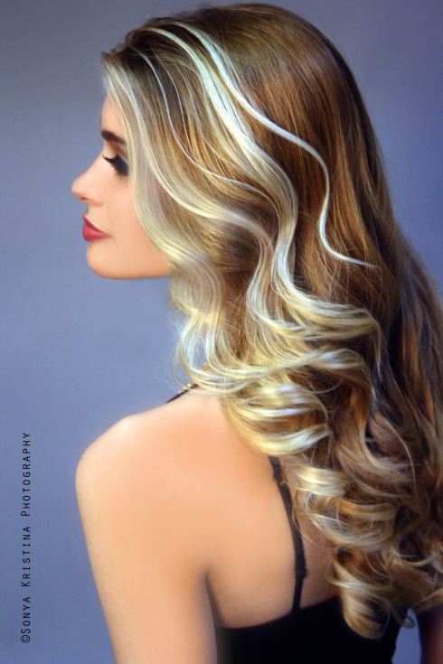 Long, blonde hairstyle with platinum highlights
