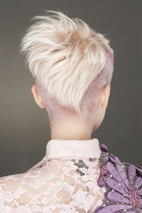 Short, pixie haircut with shaved violet sides