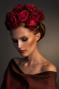 Fancy updo with red flowers