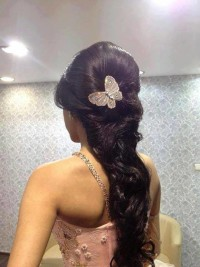 Long, brown braid with butterfly