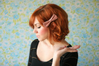 Medium-length, red hairstyle with lovely pink ribbon