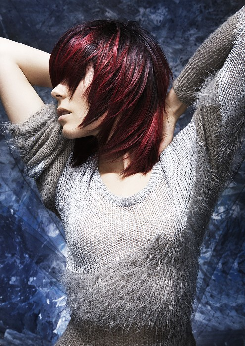 Medium-length, choppy, red hairstyle with hihglights