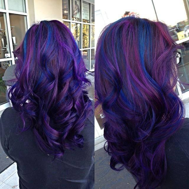 Long, curly purple hair with blue highlights