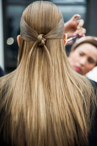 Long, blonde hairstyle with knot hair