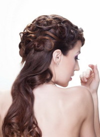 Long, brown updo with stylised streaks of hair
