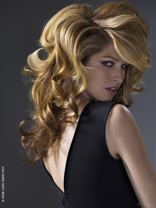 Long, thick, curly, blonde hairstyle