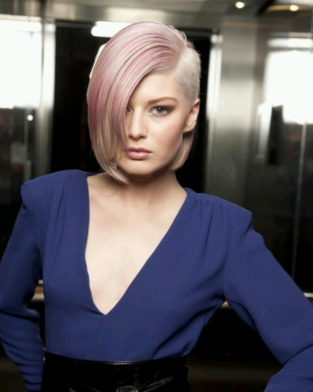 Short, pixie hairstyle with pink hair and shaved side