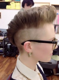 Short, pixie hairstyle with mohawk and shaved side