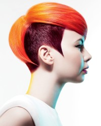 Short, two-toned haircut with red hair and darker sides