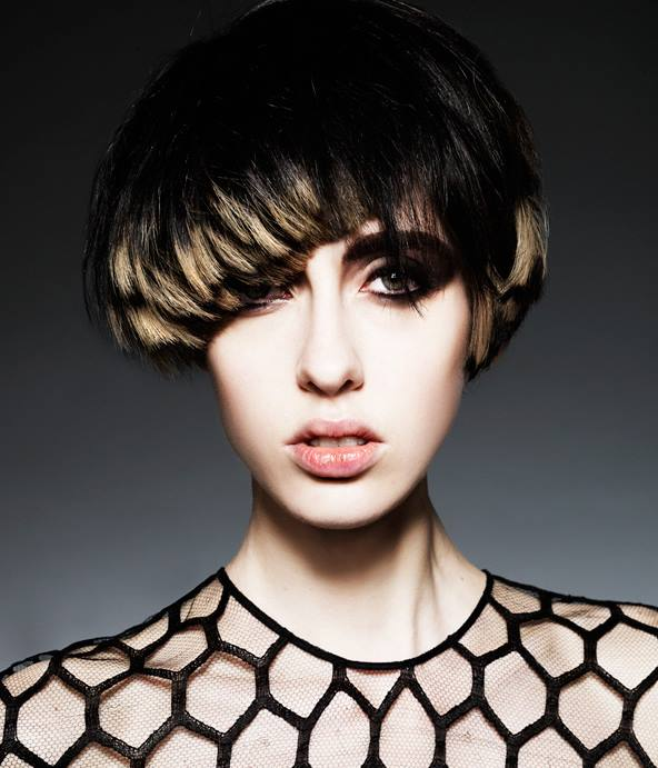 Short, bowl cut hairstyle for black hair with blonde highlights