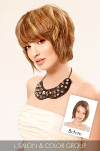 Short, brown hairstyle with blonde highlights and blunt bangs