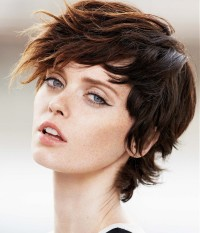 Short, choppy, wavy, brown hairstyle