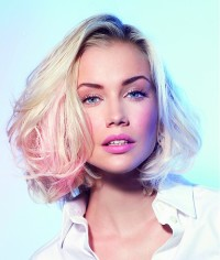 Medium-length, blonde hairstyle with pink highlights