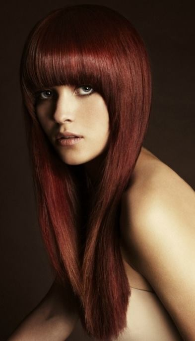 Long, straight, red hairstyle with blunt bangs