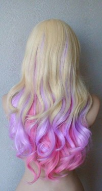Long, blonde hairstyle with pink, curly endings