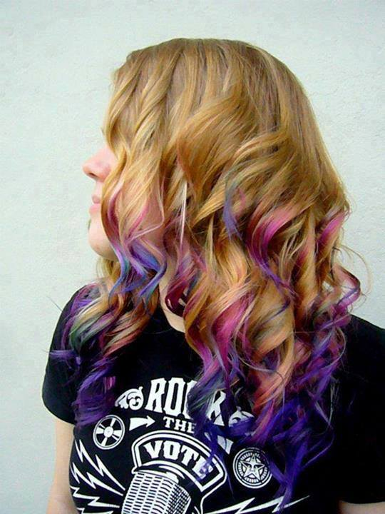 Long, curly, blonde hairstyle with blue and pink endings