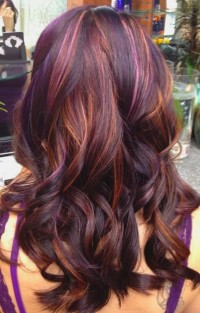 Long, dark red hairstyle with curls and orange highlights