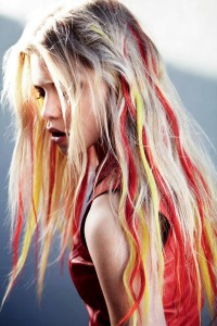 Long, colourful hairstyle with red and yellow highlights