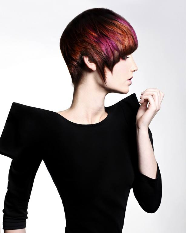 Short, dark red hairstyle