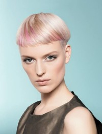 Short, bowl cut hairstyle for blonde women with pink highlights