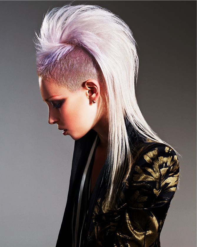 Long, violet haircut with mohawk and shaved sides