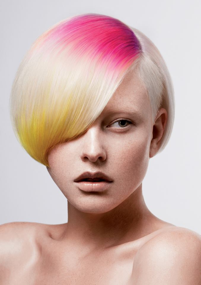 Short, colourful hairstyle with pink and yellow highlights